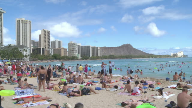 People enjoying at Waikiki beach in Honolulu, Hawaii