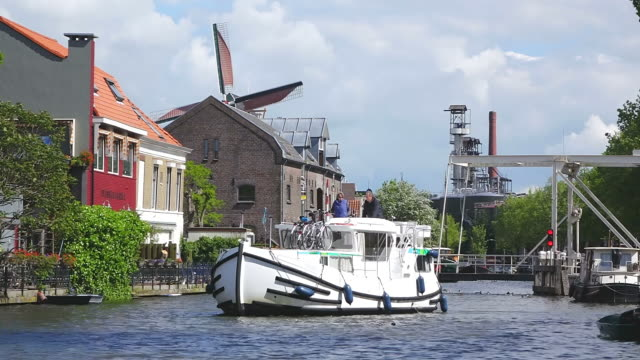 MS People enjoying boating at canal at Turfsingel / Gouda, South Holland, Netherlands