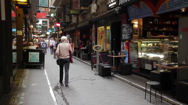 MS SLO MO People enjoying café and restaurant culture in city lane / Melbourne, Victoria, Australia