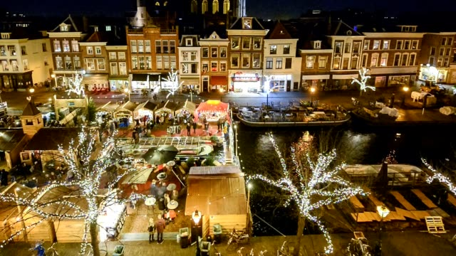 people enjoying  christmas market in leiden, the netherlands - town square stock videos & royalty-free footage