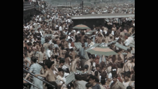 1941 - people enjoying crowded beach, coney island, new york city, ny, usa - 1941 stock-videos und b-roll-filmmaterial
