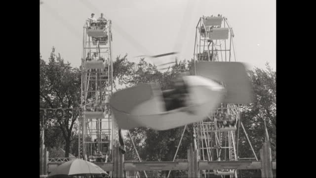 ws people enjoying fairground ride / united states - 1950 stock videos & royalty-free footage