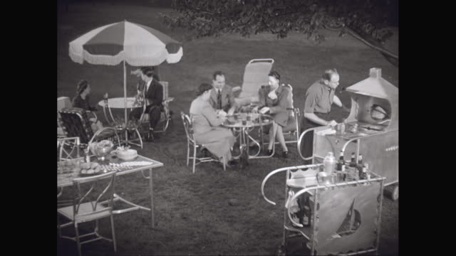 vídeos de stock e filmes b-roll de ms people enjoying garden party / united states - 1950