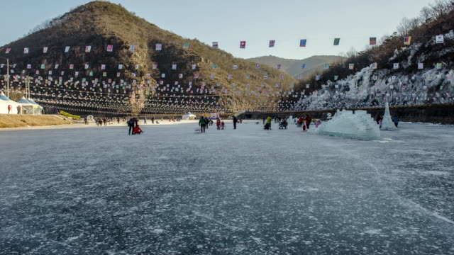 ws t/l people enjoying ice festival / andong, gyeongsangbukdo, south korea - skimboard stock videos and b-roll footage