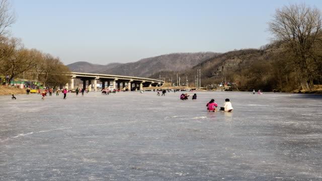 ws t/l people enjoying ice festival / andong, gyeongsangbukdo, south korea - schneefestival stock-videos und b-roll-filmmaterial