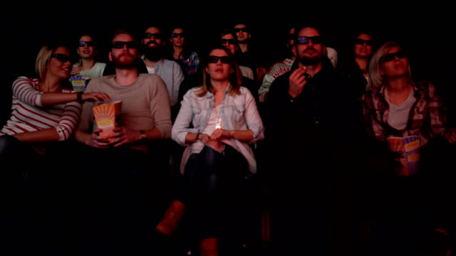 people enjoying in the cinema watching a movie - auditorium stock videos and b-roll footage