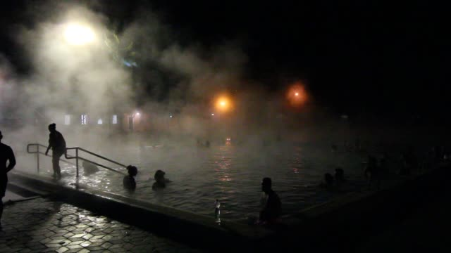 people enjoying night thermal pools bath are seen in bogacs, hungary on 1 november 2019 the thermal water of bogacs effectively promotes healing of... - ulcer stock videos & royalty-free footage