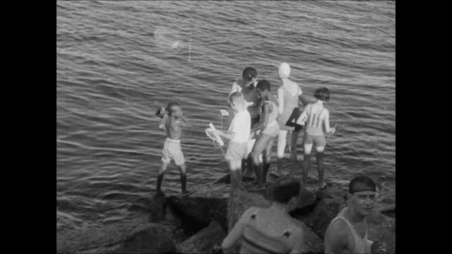 "people enjoying rio de janeiro beaches - ""archive farms"" stock videos & royalty-free footage"