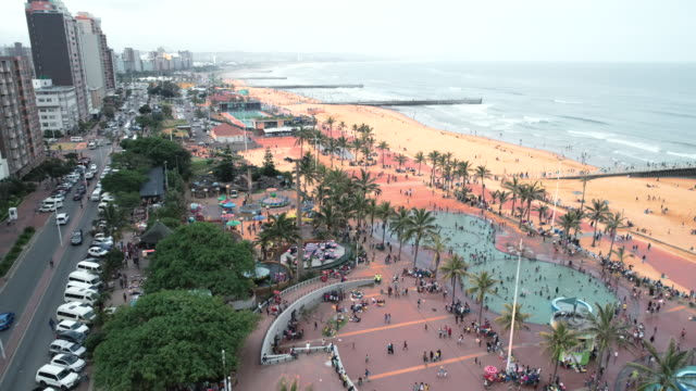 people enjoying the pools and water slides at an amusement park on the durban beachfront - water slide stock videos & royalty-free footage