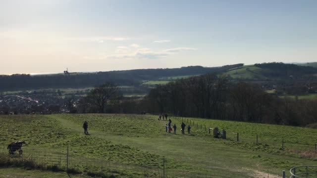 people enjoying the sunshine at cissbury ring in worthing, west sussex, as strict social distancing measures come into force across the uk. - worthing点の映像素材/bロール