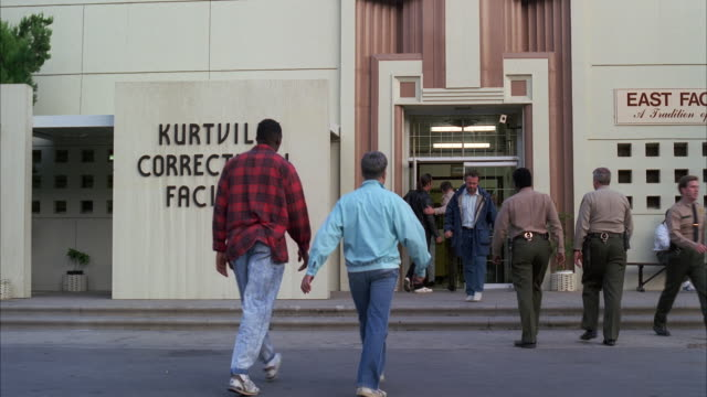 ms zi people enteingr and exiting in 'kurtville correctional facility' - western script stock videos & royalty-free footage