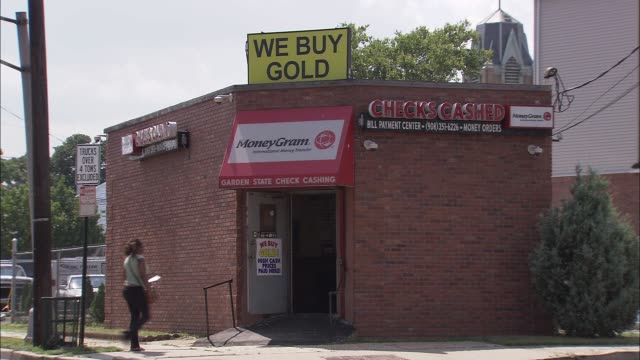 People enter a check cashing/pawn shop / Building Exterior Check Cashing Store on August 17 2011 in Elizabeth New Jersey