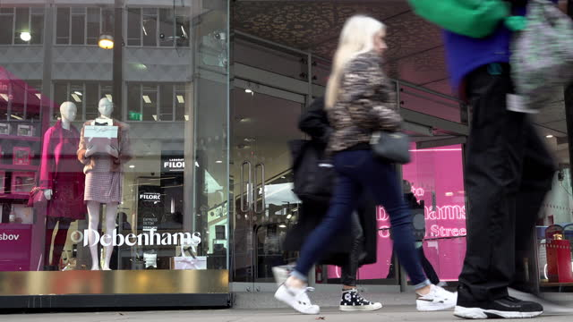 people enter and leave the debenhams department store on oxford street on the first morning the new covid regulation three tier system is implemented... - turning on or off stock videos & royalty-free footage