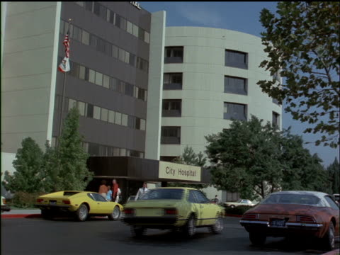 people entering and exiting a hospital. - medical building stock videos and b-roll footage