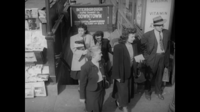 1948 nyc - people entering and leaving interborough (irt) subway entrance - 1948 stock-videos und b-roll-filmmaterial