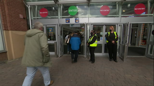 people entering bridges shopping centre in sunderland, security guards reminding customers to wear face masks during coronavirus pandemic - shopping centre stock videos & royalty-free footage