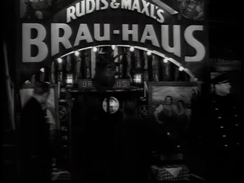 1938 ms people entering building beneath sign for rudi's and maxi's brau-haus / new york, usa - 1938 stock videos & royalty-free footage