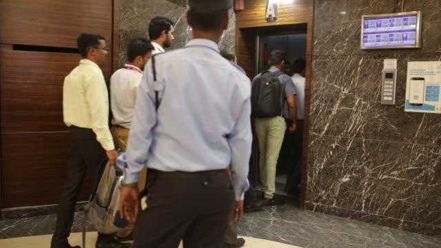 people entering elevator at bombay stock exchange building mumbai maharashtra india on monday may 21 2019 - corporate business stock videos & royalty-free footage