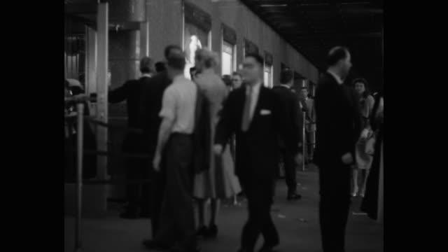 people entering in radio city music hall, rockefeller center, midtown manhattan, new york city, new york state, usa - radio city music hall stock videos & royalty-free footage