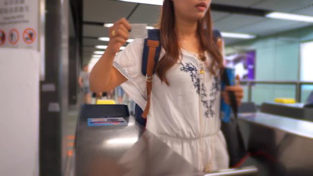 People entering in the Hong Kong subway