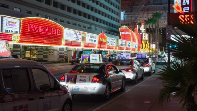 ws t/l people entering into taxis at taxi stand during night / las vegas, nevada, united states  - taxi stand stock videos and b-roll footage