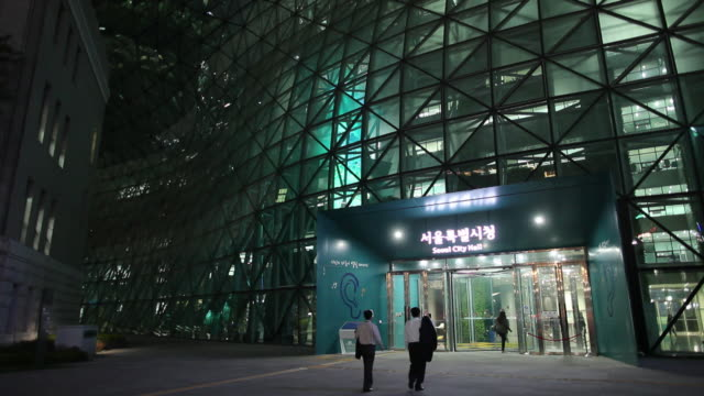 WS People entering modern office building at night / Seoul, South Korea