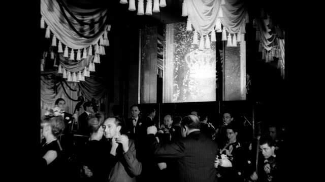 NIGHT People entering Monte Carlo Night Club doorman INT MS Couples slow dancing band VS Elderly couple talking laughing at dining table Dinner night...