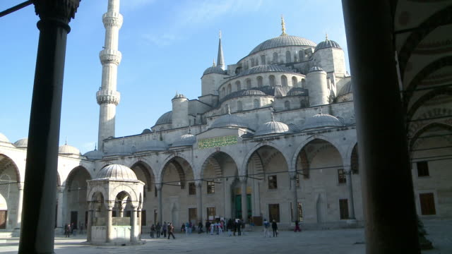 People entering to Blue Mosque in Istanbul, Turkey