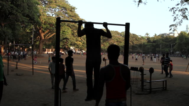 People exercise in a park in Mumbai.