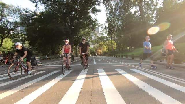 people exercise on center drive in central park as the city continues phase 4 of re-opening following restrictions imposed to slow the spread of... - bicycle stock videos & royalty-free footage