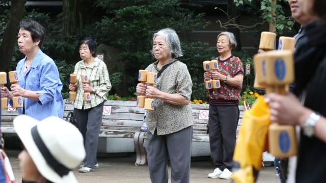 people exercise with wooden dumbbells during an event marking respect for the aged day at a temple in the sugamo district of tokyo, japan, on monday,... - respect stock videos & royalty-free footage