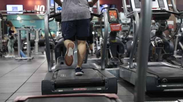 people exercising at crunch fintess gym after its reopening during covid-19 pandemic in burbank, california, u.s., on tuesday, june 23, 2020. - low section stock videos & royalty-free footage