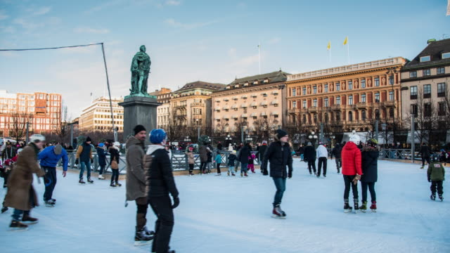 people exercising ice-skating on outdoor ice rinks around the statue, situated in stockholm, sweden - stockholm stock videos & royalty-free footage