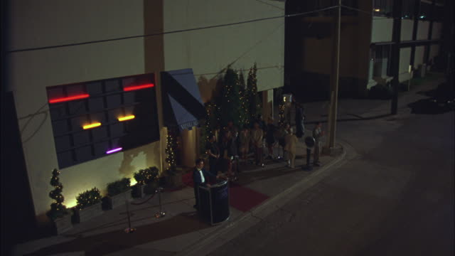 People exit a bar.