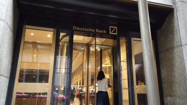 people exit deutsche bank's manhattan headquarters following news that the global banking giant will be letting go of thousands of employees due to a... - deutsche bank stock videos & royalty-free footage