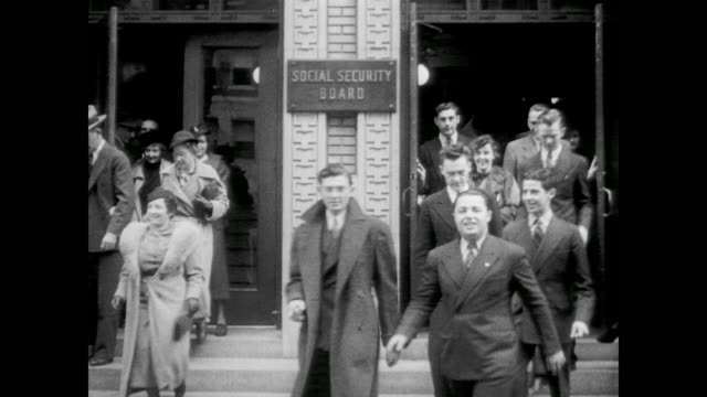 1936 people exit the social security administration building in washington d.c. - 社会保障点の映像素材/bロール