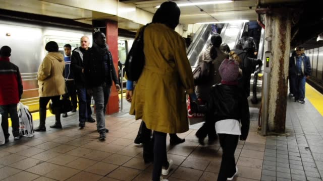 people exiting 34 th street herald square subway station on black friday black friday shoppers on november 23 2012 in new york new york - railroad station platform stock videos & royalty-free footage