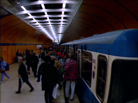 stockvideo's en b-roll-footage met people exiting train into crowded subway station - 1992