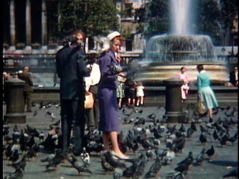 1958 ws people feeding pigeons on trafalgar square, london, england - anno 1958 video stock e b–roll