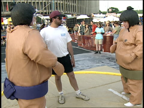 people fighting in inflatable sumo suits - inflatable stock videos & royalty-free footage