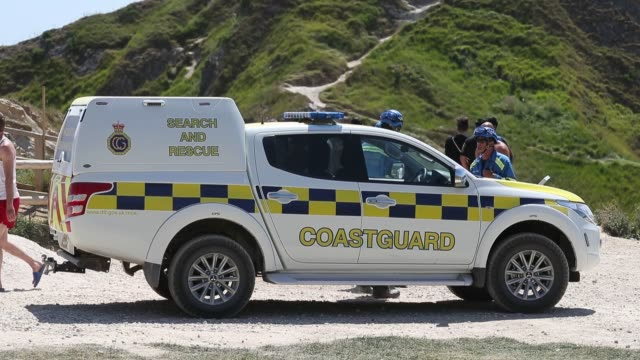 people fill the beach at durdle door, near lulworth, despite dorset council announcing that the beach was closed to the public after three people... - jumping stock videos & royalty-free footage