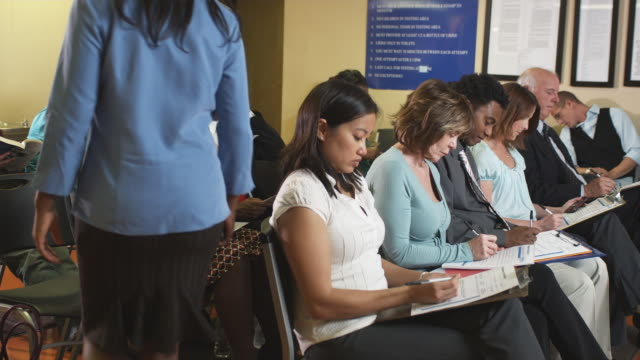 MS, PAN, People filling forms in unemployment office, Phoenix, Arizona, USA