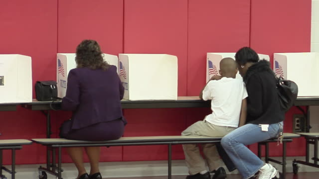 ms, people filling in voting ballots sitting at voting booths, toledo, ohio, usa - voting booth stock videos & royalty-free footage