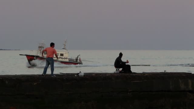 people fishing at puertito del buceo, montevideo, uruguay - montevideo stock videos & royalty-free footage