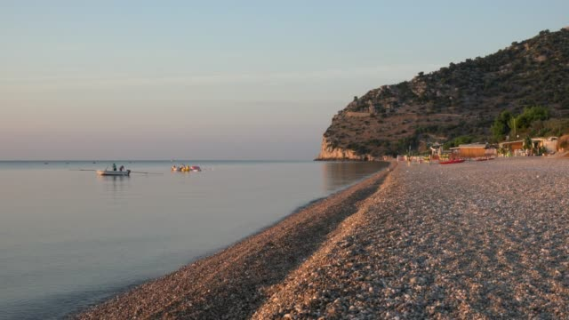 people fishing in boat at mattinata piana beach in the morning - adriatic sea stock videos & royalty-free footage