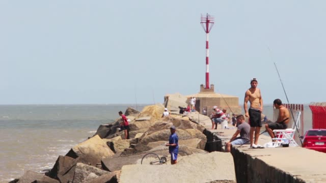 "people fishing in ""escollera sarandí"", montevideo, uruguay, 2015 - uruguay stock-videos und b-roll-filmmaterial"