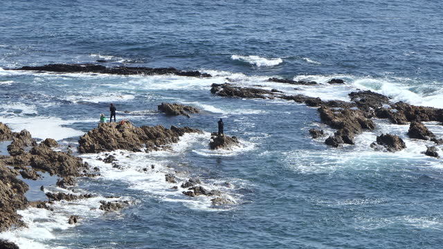 people fishing off the rocks at white point, southern california, san pedro, - serene people stock videos & royalty-free footage