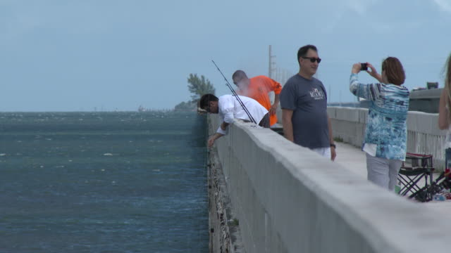 People Fishing Off The Seven Mile Bridge, Florida Keys, Tourists