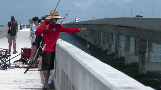 people fishing off the seven mile bridge, florida keys, tourists - the florida keys stock videos & royalty-free footage