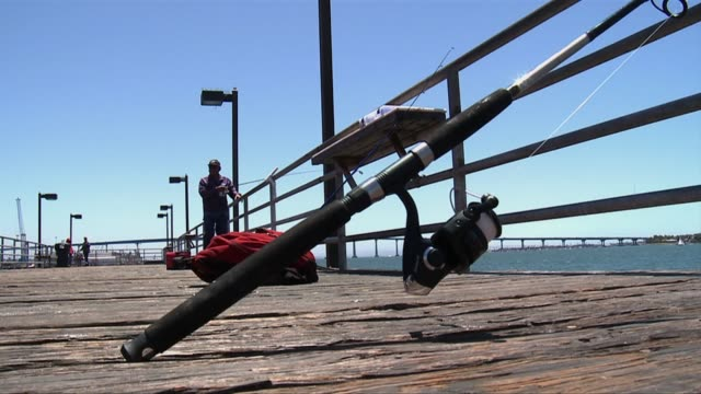 people fishing on a pier on june 03 2011 in san diego california - hook stock videos & royalty-free footage